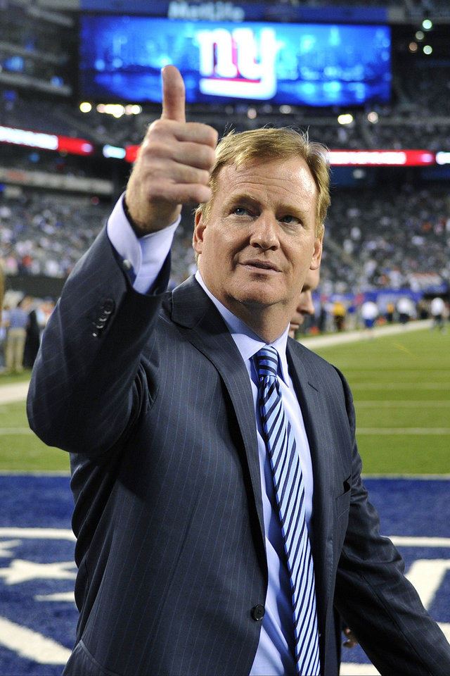 Photo -   Commissioner Roger Goodell gestures to fans before an NFL football game between the New York Giants and the Dallas Cowboys, Wednesday, Sept. 5, 2012, in East Rutherford, N.J. (AP Photo/Bill Kostroun)