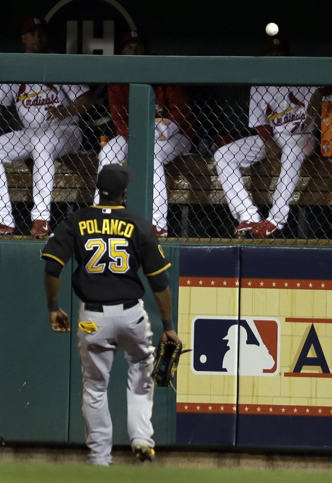 Photo - Pittsburgh Pirates right fielder Gregory Polanco watches as a ball hit by St. Louis Cardinals' Kolten Wong lands over the outfield wall for a solo home run during the seventh inning of a baseball game Wednesday, July 9, 2014, in St. Louis. (AP Photo/Jeff Roberson)