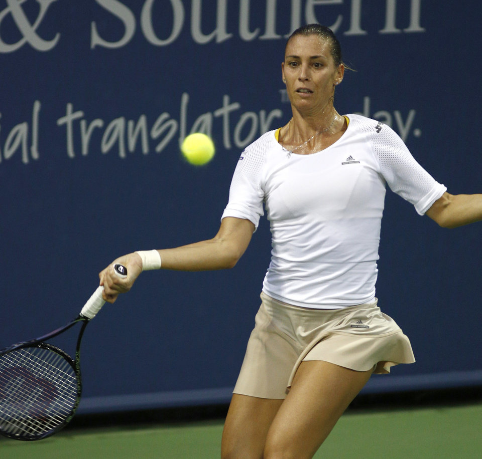 Photo - Flavia Pennetta, from Italy, returns to Chanelle Scheepers, from South Africa, in a first round match at the Western & Southern Open tennis tournament, Monday, Aug. 11, 2014, in Mason, Ohio. (AP Photo/David Kohl)