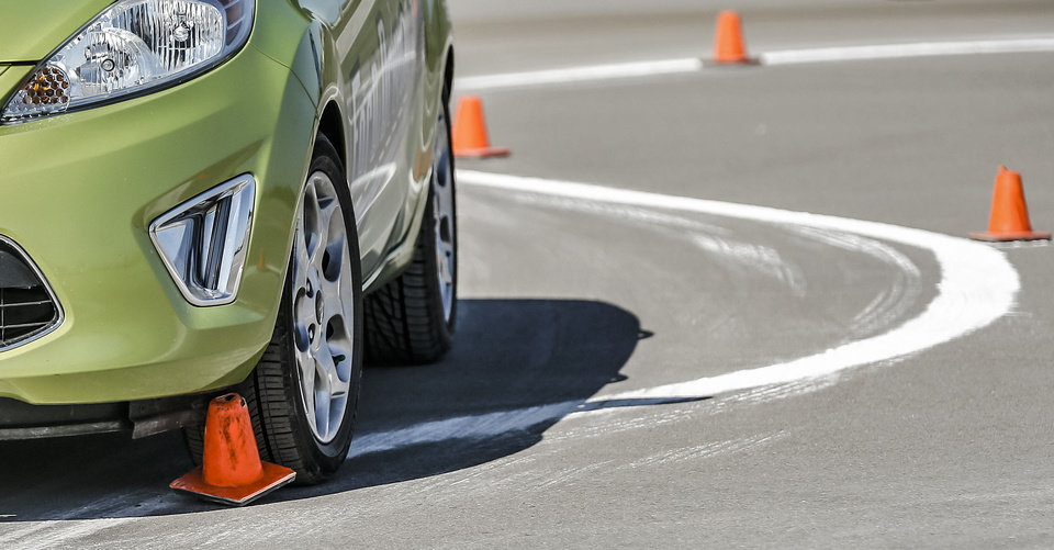DRIVING SKILLS COURSE: A driver hits a cone while navigating a course during the Ford Driving Skills For Life interactive course at Yukon High School on Thursday, April 11, 2013, in Yukon, Okla. Photo by Chris Landsberger, The Oklahoman ORG XMIT: KOD