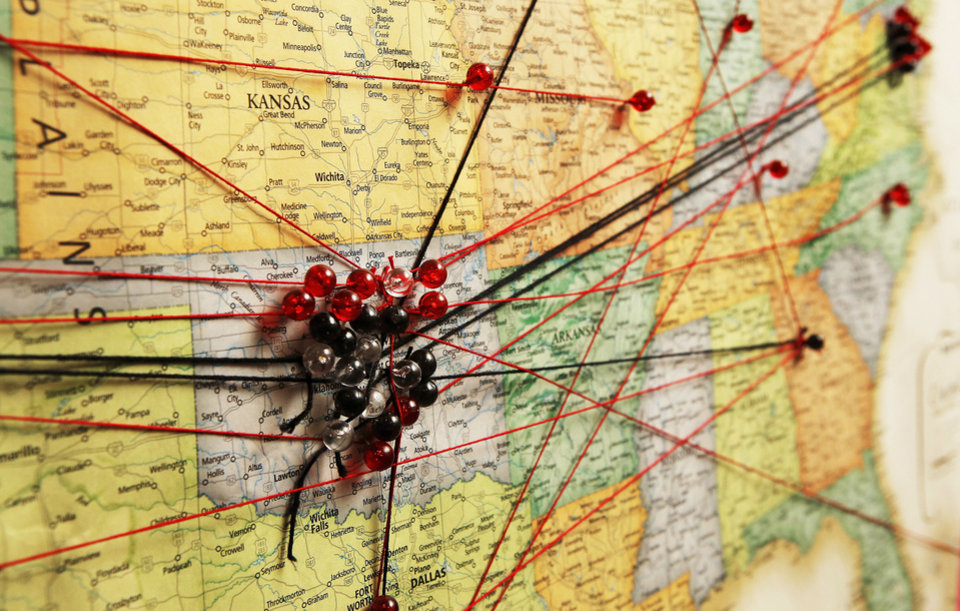 Photo - Push pins and string represent the hometowns of children and grandchildren of residents at the Fountains at Canterbury. They created the map to illustrate where their offspring live throughout the United States and overseas.  Photo  by Jim Beckel, The Oklahoman.  Jim Beckel - THE OKLAHOMAN
