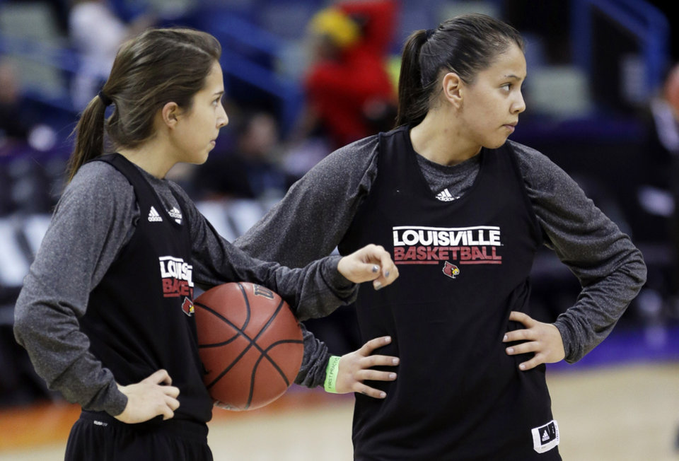Louisville\'s Jude Schimmel, left, and her sister Shoni Schimmel warm up during practice at the Women\'s Final Four of the NCAA college basketball tournament, Saturday, April 6, 2013, in New Orleans. Louisville plays California in a semifinal game on Sunday. (AP Photo/Gerald Herbert)