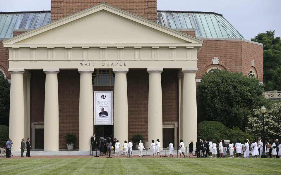 Photo - Mourners make their way into Wait Chapel before a memorial service for poet and author Maya Angelou at Wait Chapel. at Wake Forest University in Winston-Salem, N.C., Saturday, June 7, 2014. Former President Bill Clinton and Oprah Winfrey are joining First Lady Michelle Obama at the service. (AP Photo/Chuck Burton)
