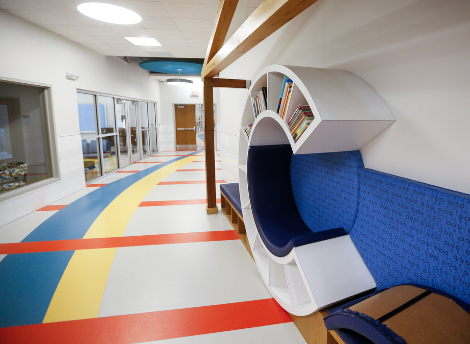 Photo - Clayton's Clubhouse, right, a take-home library, is along the wall of the main hall at the new facility for Positive Tomorrows, a school for homeless children, at 901 N Villa in Oklahoma City, Tuesday, Nov. 26, 2019. [Nate Billings/The Oklahoman]