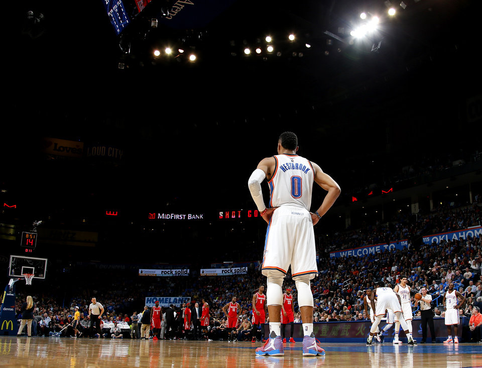 Photo - Oklahoma City's Russell Westbrook (0) during an NBA basketball game between the Oklahoma City Thunder and the Houston Rockets at Chesapeake Energy Arena in Oklahoma City, Friday, Jan. 29, 2016. Oklahoma City won 116-108. Photo by Bryan Terry, The Oklahoman