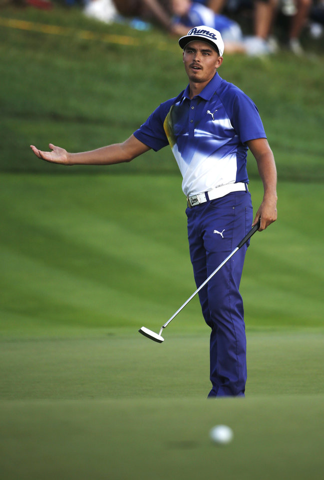 Photo - Rickie Fowler reacts after missing his putt on the 18th hole during the third round of the PGA Championship golf tournament at Valhalla Golf Club on Saturday, Aug. 9, 2014, in Louisville, Ky. (AP Photo/Mike Groll)