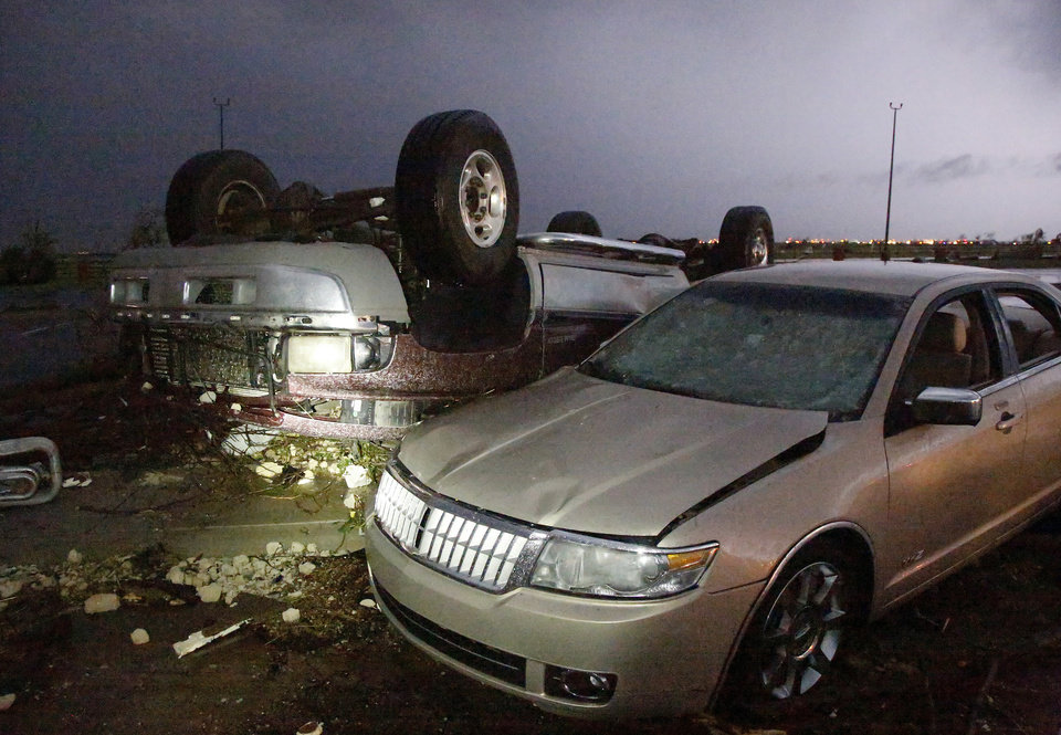 Photo -  Damaged cars are seen in the parking lot at Canadian Valley Technology Center after the May 31 tornado. Photos by Jim Beckel, The Oklahoman Archives   Jim Beckel -