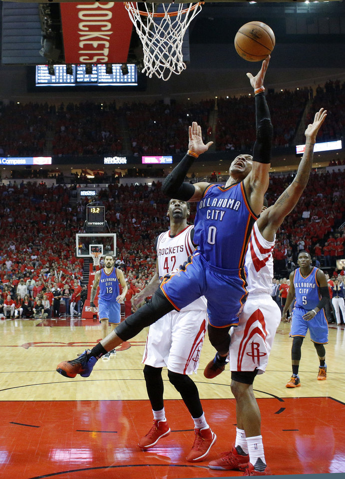 Photo - Oklahoma City's Russell Westbrook (0) goes to the basket during Game 5 in the first round of the NBA playoffs between the Oklahoma City Thunder and the Houston Rockets in Houston, Texas,  Tuesday, April 25, 2017.  Houston won 105-99. Photo by Sarah Phipps, The Oklahoman