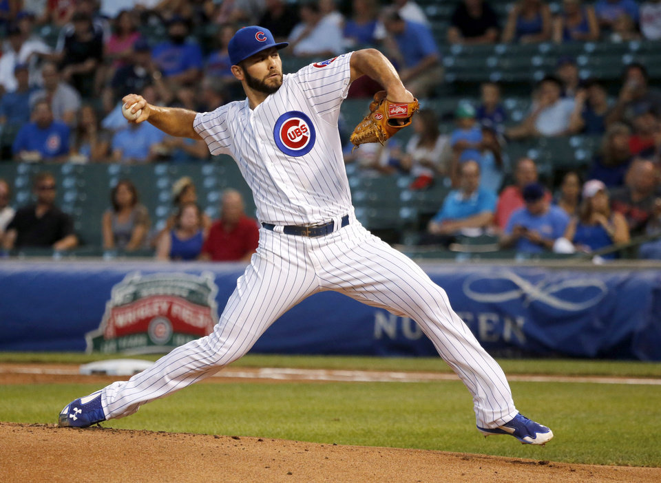 Photo - Chicago Cubs starting pitcher Jake Arrieta delivers during the first inning of a baseball game against the Milwaukee Brewers, Tuesday, Sept. 2, 2014, in Chicago. (AP Photo/Charles Rex Arbogast)