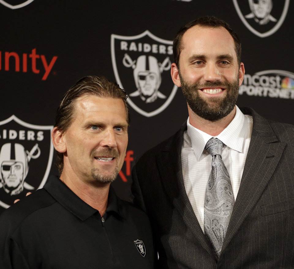 Photo - Oakland Raiders quarterback Matt Schaub, right, stands with offensive coordinator Greg Olson after a news conference Friday, March 21, 2014, at the NFL football team's practice facility in Alameda, Calif. Schaub and the Raiders are both hoping to put the mistakes of 2013 in the past. The Raiders acquired Schaub from Houston for an undisclosed draft pick, giving the quarterback a second chance after he lost his starting job with the Texans last season. (AP Photo/Ben Margot)