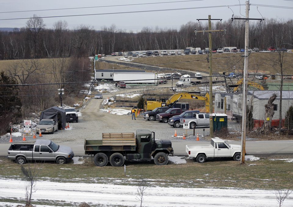 In this Thursday, Feb. 7, 2013 photo, the view from the Baum family's front porch is of vehicles parked at the construction site for a natural gas compressor station in Minisink, N.Y. Residents of Minisink want federal regulators to reconsider their proposal to put the industrial facility on a more remote company-owned site that�s farther from homes and farms. (AP Photo/Mike Groll)