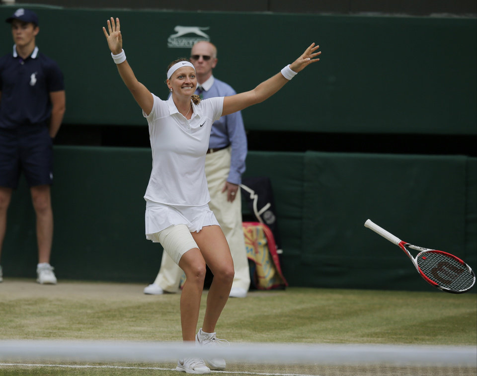 Photo - Petra Kvitova of Czech Republic celebrates after defeating Eugenie Bouchard of Canada in the women's singles final at the All England Lawn Tennis Championships in Wimbledon, London, Saturday, July 5, 2014. (AP Photo/Pavel Golovkin)