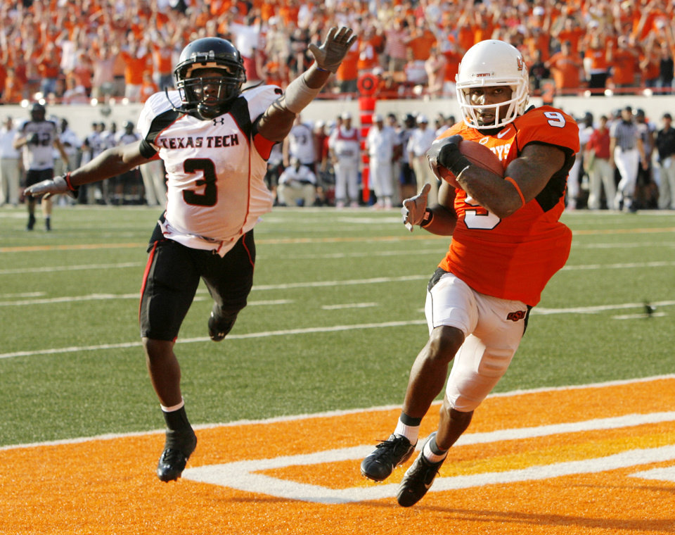 OSU's Jeremy Broadway (9) catches a touchdown pass from Seth Newton (15) on a trick play in front of Jamar Wall (3) of Texas Tech during the in the third quarter of the college football game between the Oklahoma State University Cowboys (OSU) and the Texas Tech University Red Raiders (TTU) at Boone Pickens Stadium in Stillwater, Okla., on Saturday, Sept. 22, 2007. OSU won, 49-45. By NATE BILLINGS, The Oklahoman