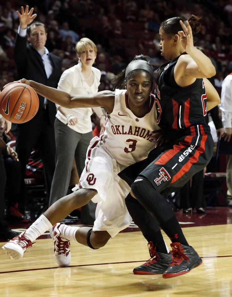 Oklahoma Sooner\'s Aaryn Ellenberg (3) drives around Monique Smalls (23) as the University of Oklahoma Sooners (OU) play the Texas Tech Lady Red Raiders in NCAA, women\'s college basketball at The Lloyd Noble Center on Saturday, Jan. 12, 2013 in Norman, Okla. Photo by Steve Sisney, The Oklahoman