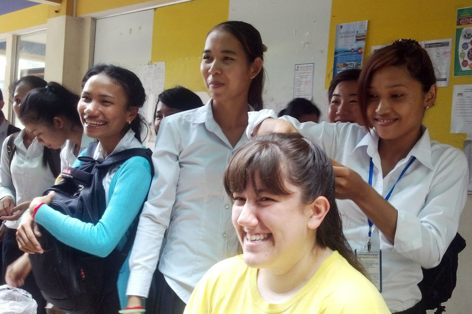 Katie Gilbert, center, an Oklahoma Baptist University sophomore from Sapulpa, gets her hair braided by a new friend in Cambodia. Gilbert was one of four OBU representatives to travel to the tropical nation during the summer semester. Photo provided <strong></strong>