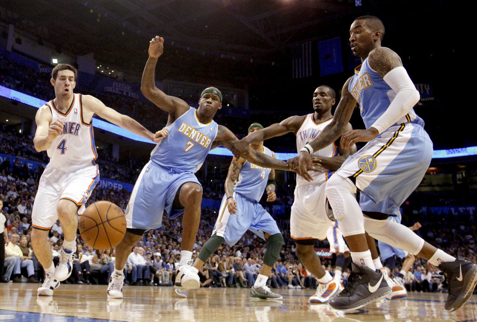 Photo - Oklahoma City's Nick Collison (4) and Oklahoma City's Serge Ibaka (9) fight Denver's Al Harrington (7) and  J.R. Smith (5) for a loose ball during the NBA basketball game between the Oklahoma City Thunder and the Denver Nuggets, Friday, April 8, 2011, at the Oklahoma City Arena.. Photo by Sarah Phipps, The Oklahoman