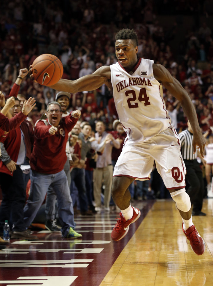 Photo - Oklahoma's Buddy Hield (24) saves a pass from join out of bounds in the final minute as the University of Oklahoma Sooner (OU) men defeat the West Virginia Mountaineers (WV) 70-68 in NCAA, college basketball at The Lloyd Noble Center on Jan. 16, 2016 in Norman, Okla. Photo by Steve Sisney, The Oklahoman