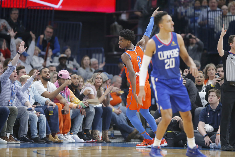 Photo - Oklahoma City's Shai Gilgeous-Alexander (2) celebrates after a basket during an NBA basketball game between the Oklahoma City Thunder and the LA Clippers at Chesapeake Energy Arena in Oklahoma City, Sunday, Dec. 22, 2019. Oklahoma City won 118-112. [Bryan Terry/The Oklahoman]
