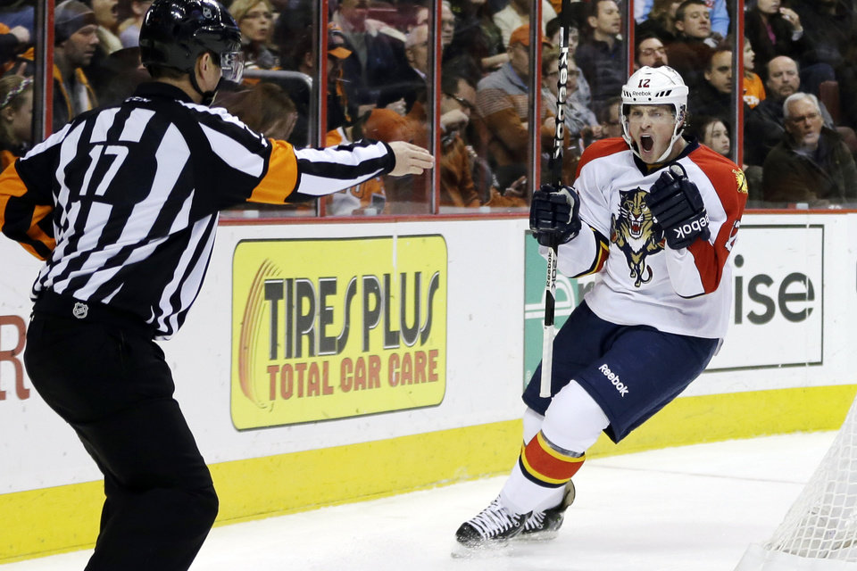 Florida Panthers' Jack Skille, right, celebrates as referee Frederick L'Ecuyer signals after Skille's goal during the first period of an NHL hockey game against the Philadelphia Flyers, Thursday, Feb. 7, 2013, in Philadelphia. (AP Photo/Matt Slocum)