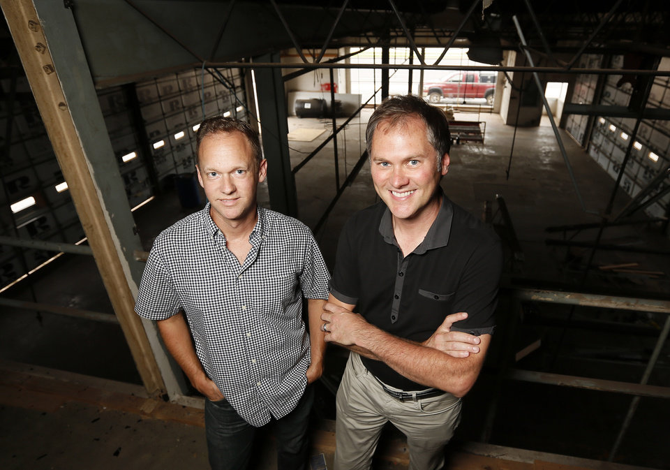 Photo -  Co-owners and developers Ben Sellers, left, and David Wanzer stand inside the half-century old service station along Classen Boulevard they are redeveloping as a restaurant and retail space at 916 NW 6.   NATE BILLINGS -  NATE BILLINGS
