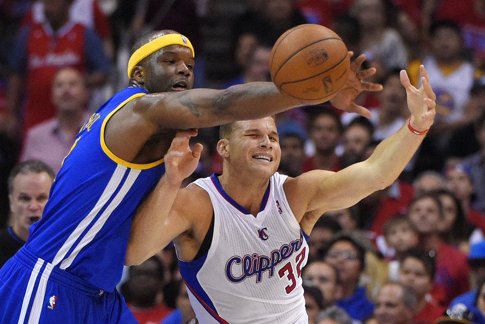Photo - Golden State Warriors center Jermaine O'Neal, left, blocks a pass meant for Los Angeles Clippers forward Blake Griffin during the second half in Game 1 of an opening-round NBA basketball playoff series, Saturday, April 19, 2014, in Los Angeles. The Warriors won 109-105. (AP Photo/Mark J. Terrill)