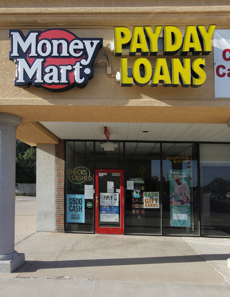 Photo -  A Money Mart, 9246 N Pennsylvania Ave., store is seen in Oklahoma City. Photos by Paul B. Southerland, The Oklahoman   PAUL B. SOUTHERLAND
