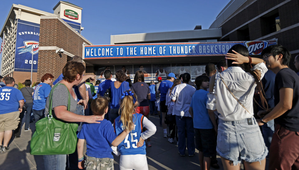 Photo - Fans wait in line before Game 2 in the second round of the NBA playoffs between the Oklahoma City Thunder and the Memphis Grizzlies at Chesapeake Energy Arena in Oklahoma City, Tuesday, May 7, 2013. Photo by Bryan Terry, The Oklahoman