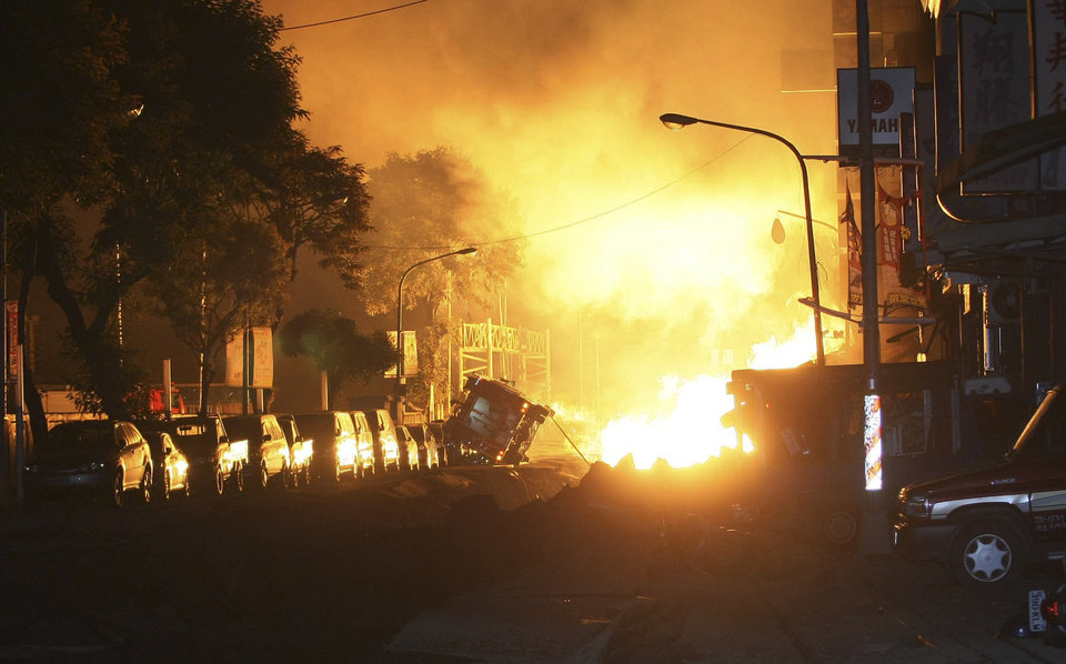Photo - Flames from an explosion from an underground gas leak in the streets of Kaohsiung, Taiwan, early Friday, Aug. 1, 2014.  A massive gas leakage early Friday caused five explosions that killed several people and injured over 200 in the southern Taiwan port city of Kaohsiung. (AP Photo)  TAIWAN OUT