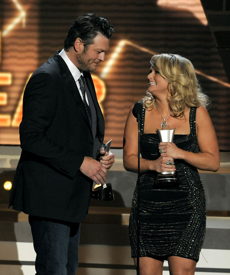 "Miranda Lambert, right, and Blake Shelton accept the award for song of the year for ""Over You"" at the 48th Annual Academy of Country Music Awards at the MGM Grand Garden Arena in Las Vegas on Sunday, April 7, 2013. (Photo by Chris Pizzello/Invision/AP) ORG XMIT: NVPM263"