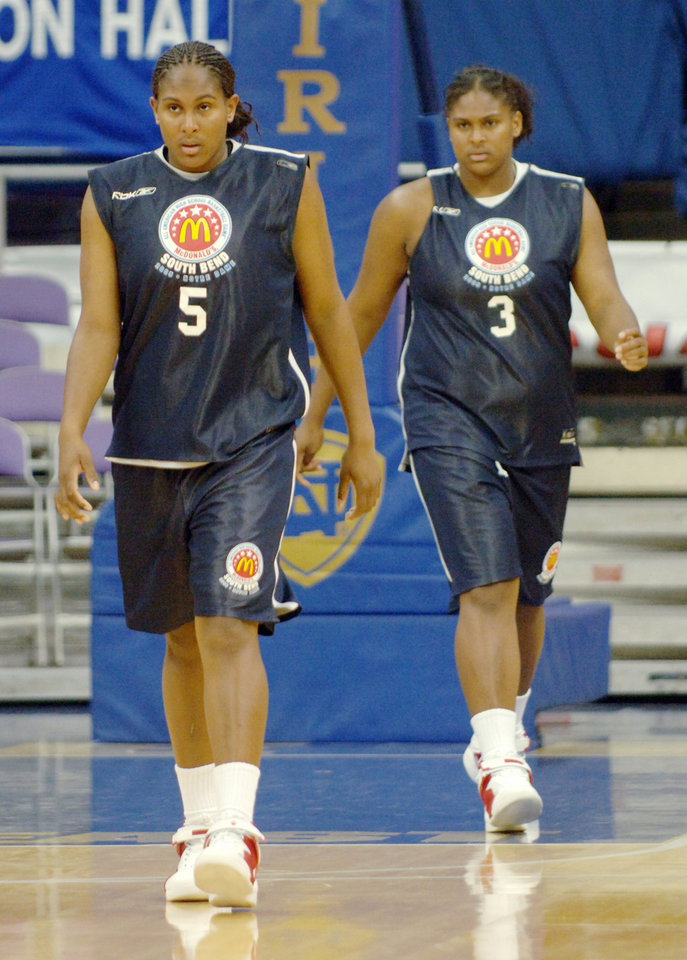 Photo - Ashley (L) and Courtney Paris (R) walk up the court during scrimmage which was a prelude to the 2005 McDonald's All American High School Basketball Game  in South Bend, Indiana, March 29, 2005.  HO-MCDONALD'S/Henny Ray Abrams
