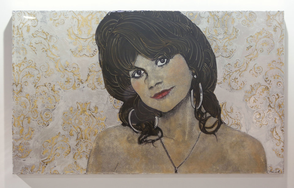Photo - In this photo taken Monday, June 24, 2013,  is a portrait of singer Linda Ronstadt, who had dated Gov. Jerry Brown during his terms as governor in the 1970's is among the paintings by artist Maren Conrad of women with sexual ties to California Governors, in Sacramento, Calif.   The show, titled
