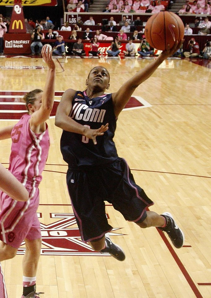 Photo -   Connecticut guard Tiffany Hayes (3) goes up for a shot in front of Oklahoma guard Whitney Hand, left, in the second half of an NCAA college basketball game in Norman, Okla., Monday, Feb. 13, 2012. Hayes had 23 points as Connecticut won 73-55. (AP Photo/Sue Ogrocki)