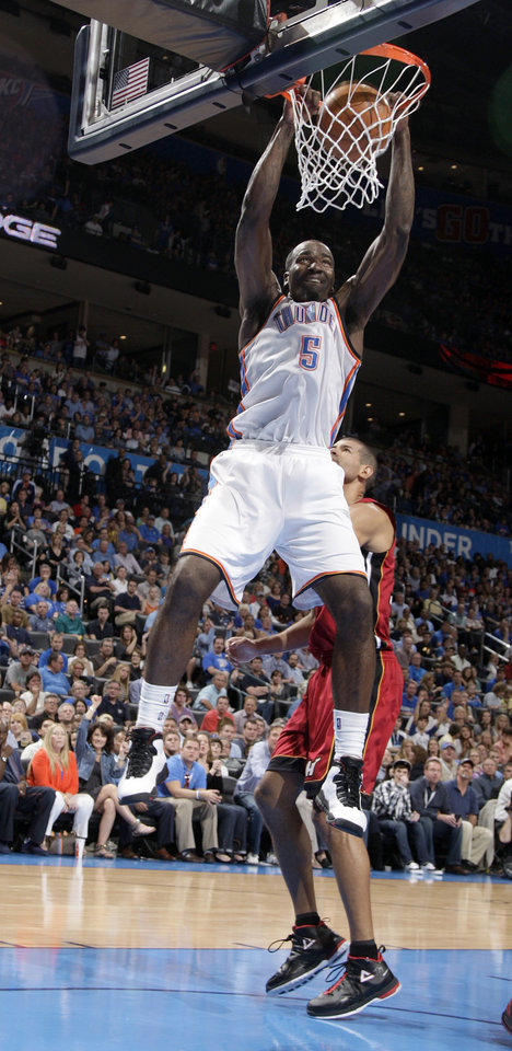 Oklahoma City's Kendrick Perkins (5) dunks in front of Miami Heat's Shane Battier (31) during the NBA basketball game between the Miami Heat and the Oklahoma City Thunder at Chesapeake Energy Arena in Oklahoma City, Sunday, March 25, 2012. Photo by Sarah Phipps The Oklahoman