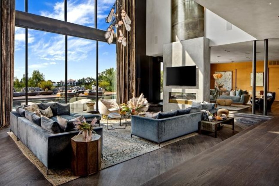 Photo -  John Legend and Chrissy Teigen's home, once owned by Rihanna, has been updated with cerused oak floors, hot-rolled steel walls and bespoke patterned ceilings from Thailand. [TNS PHOTO]