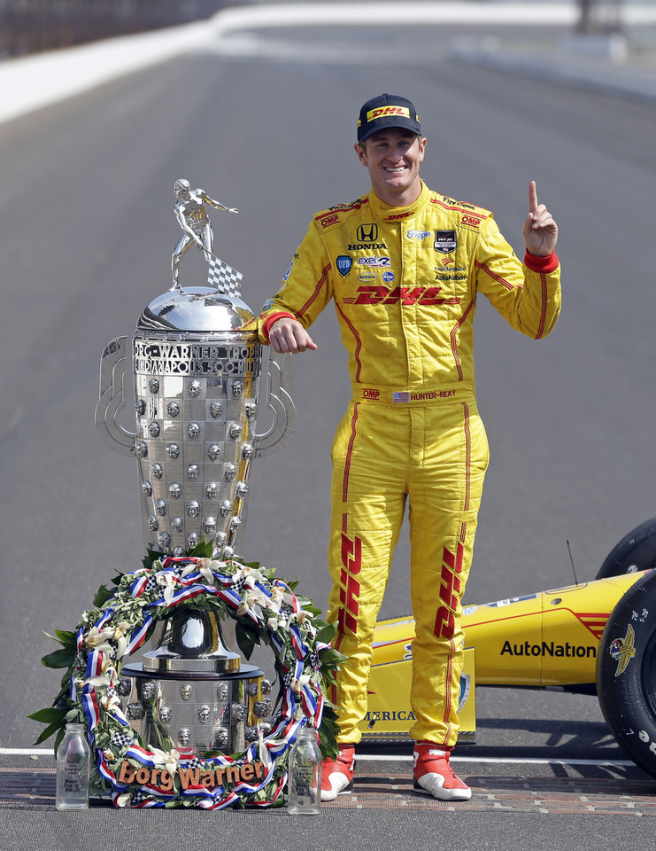 Photo - Indianapolis 500 champion Ryan Hunter-Reay poses during the traditional winners photo session on the start/finish line at the Indianapolis Motor Speedway in Indianapolis, Monday, May 26, 2014.  Hunter-Reay won the 98th running of the Indianapolis 500 IndyCar auto race on Sunday. (AP Photo/Michael Conroy)