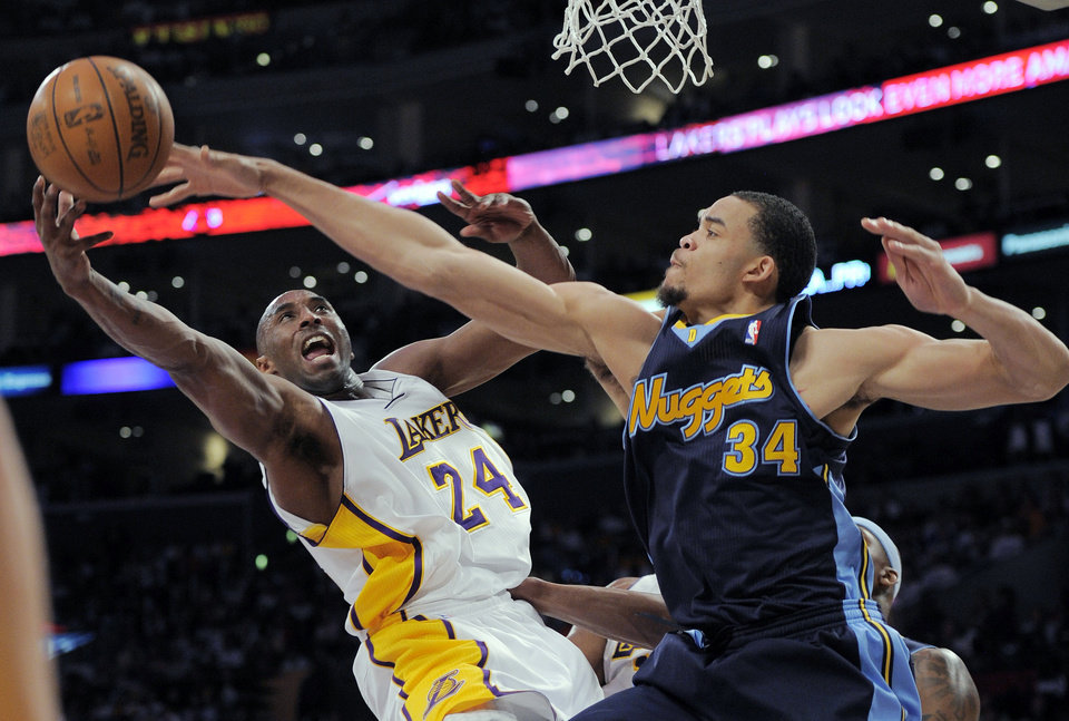 Photo -   Los Angeles Lakers guard Kobe Bryant, left, puts up a shot as Denver Nuggets center JaVale McGee defends during the first half of an NBA first-round playoff basketball game, Sunday, April 29, 2012, in Los Angeles. (AP Photo/Mark J. Terrill)