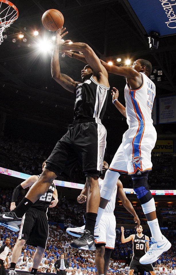 San Antonio's Kawhi Leonard (2) and Oklahoma City's Kevin Durant (35) battle for the ball during Game 4 of the Western Conference Finals between the Oklahoma City Thunder and the San Antonio Spurs in the NBA playoffs at the Chesapeake Energy Arena in Oklahoma City, Saturday, June 2, 2012.  Photo by Nate Billings, The Oklahoman