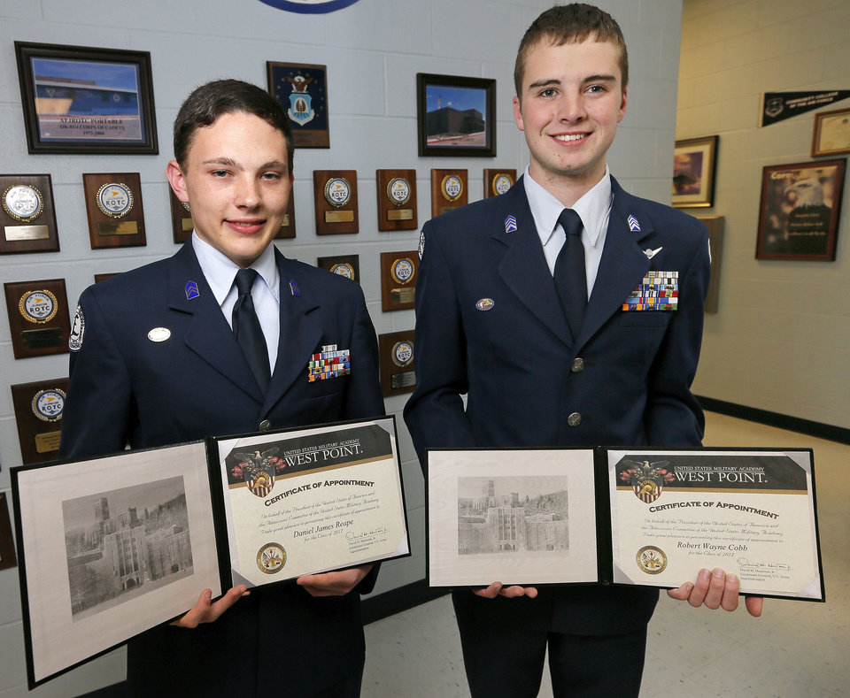 Photo - Daniel Reape, left, and Wayne Cobb, seniors in the Edmond North Air Force JROTC, show their certificates of appointment to the U.S. Military Academy at West Point. Photo by Nate Billings, The Oklahoman