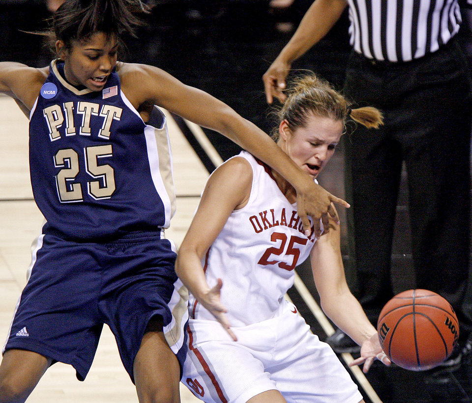 OU's Whitney Hand fights for the ball with Pittsburgh's Shayla Scott during the NCAA women's basketball tournament game between Oklahoma and Pittsburgh at the Ford Center in Oklahoma City, Sunday, March 29, 2009.  PHOTO BY BRYAN TERRY, THE OKLAHOMAN