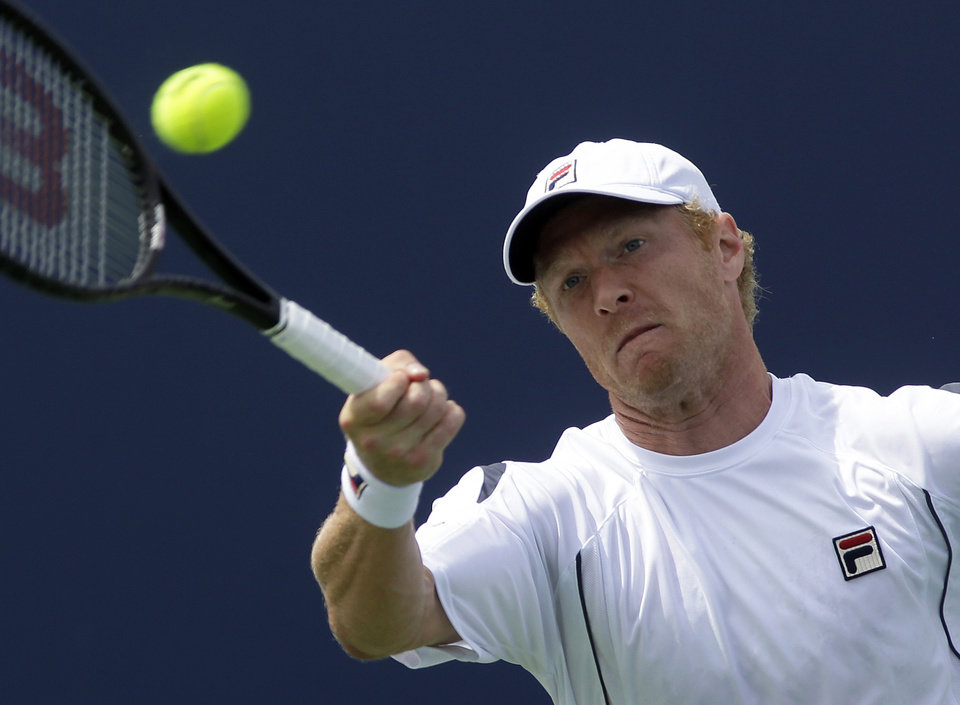 Photo - Dmitry Tursunov, from Russia, hits a forehand against David Ferrer, from Spain, during a match at the Western & Southern Open tennis tournament, Thursday, Aug. 15, 2013, in Mason, Ohio. (AP Photo/Al Behrman)