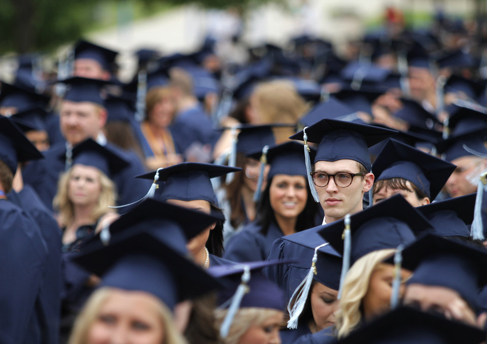 Nate Bauer, of Guymon, a Psychology major, waits with his peers before walking during a University of Central Oklahoma graduation ceremony in Edmond, Friday, May 4.  Photo by Garett Fisbeck, For The Oklahoman