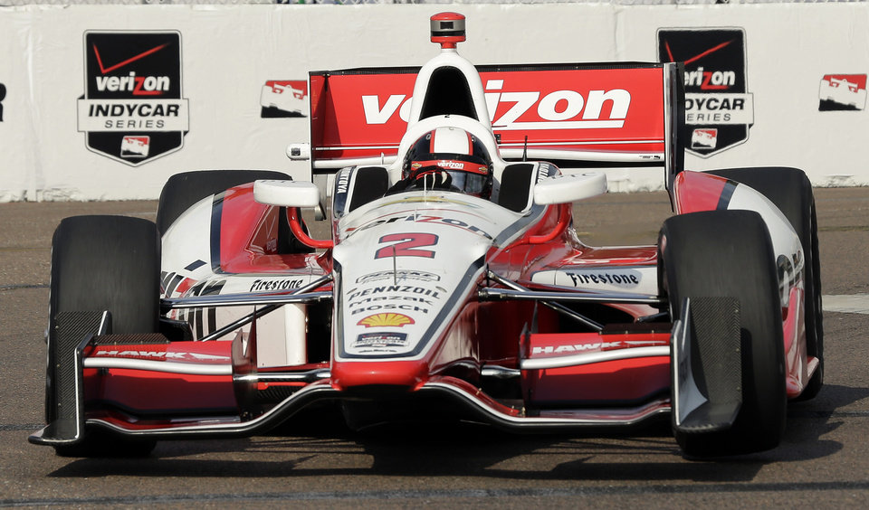 Photo - Juan Pablo Montoya, of Colombia, drives into turn 10 during practice for the IndyCar Firestone Grand Prix of St. Petersburg auto race Saturday, March 29, 2014, in St. Petersburg, Fla. The race takes place on Sunday. (AP Photo/Chris O'Meara)