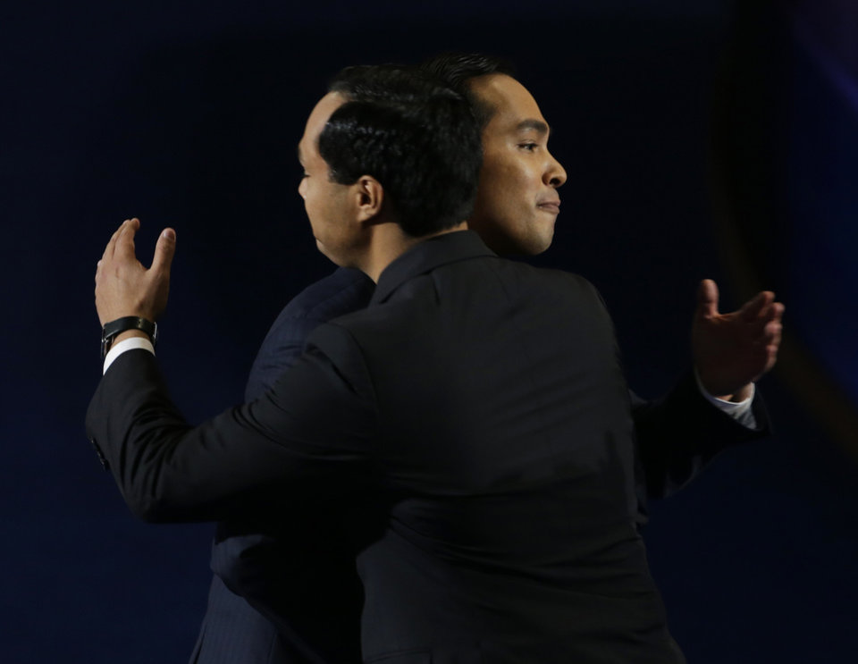 Photo - San Antonio Mayor Julian Castro, right, hugs his brother Joaquin Castro after his speech at the Democratic National Convention in Charlotte, N.C., on Tuesday, Sept. 4, 2012. (AP Photo/Lynne Sladky)  ORG XMIT: DNC514