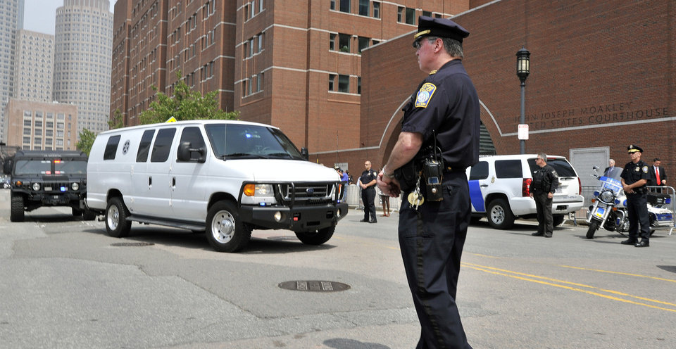 Photo - A U.S. Marshals Service van, believed to be carrying Boston Marathon bombing suspect Dzhokhar Tsarnaev, arrives at the federal courthouse for his arraignment Wednesday, July 10, 2013, in Boston. The April 15 attack killed three and wounded more than 260. The 19-year-old Tsarnaev has been charged with using a weapon of mass destruction, and could face the death penalty. (AP Photo/Josh Reynolds)