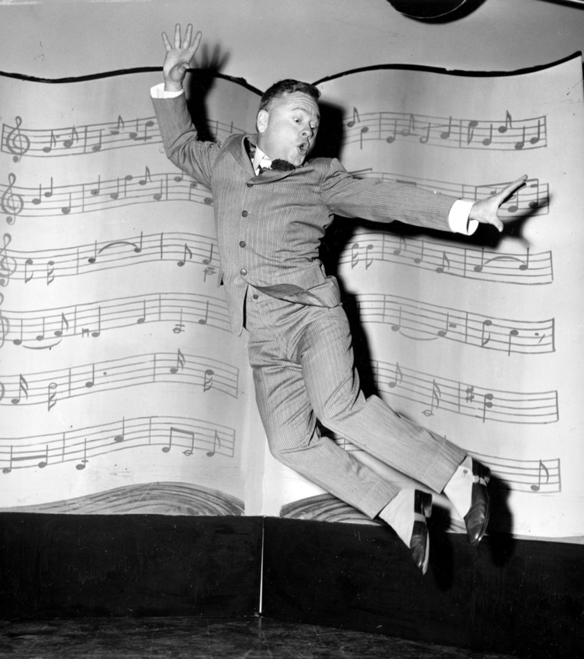 Photo - FILE - In this March 19, 1957, file photo, actor, singer and dancer Mickey Rooney, wearing spats and a pinstriped suit, performs a dance routine during rehearsal for the television show
