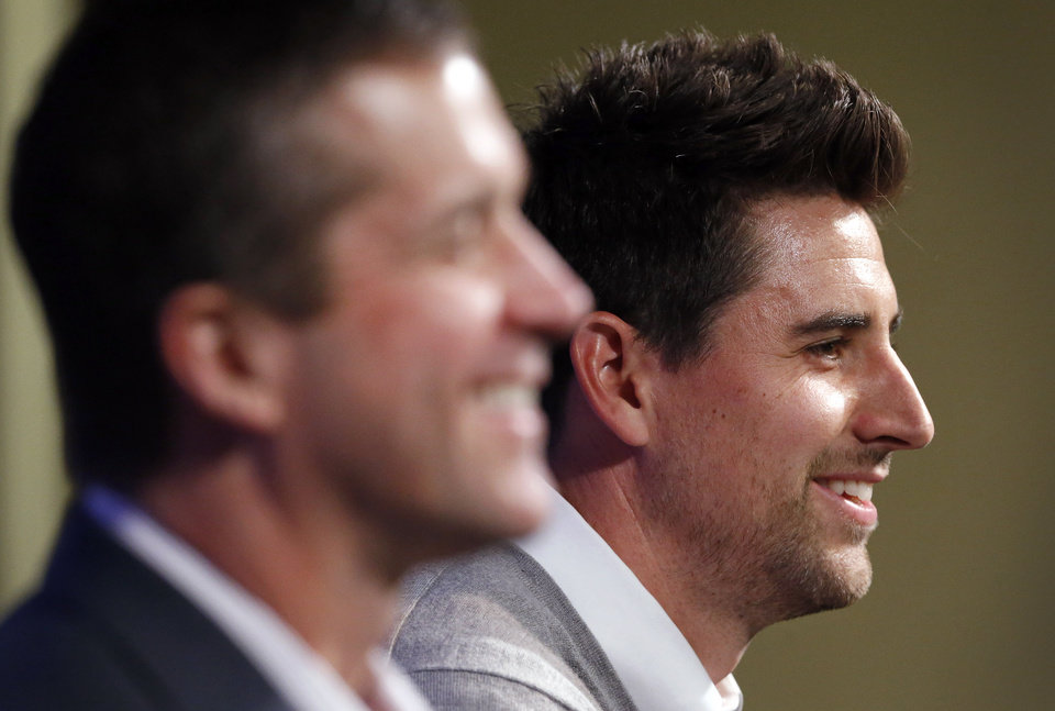 Photo - Baltimore Ravens tight end Dennis Pitta, right, sits alongside head coach John Harbaugh as he discusses his new five-year contract during an NFL football news conference, Wednesday, March 5, 2014, at the Ravens practice facility in Owings Mills, Md.  (AP Photo/Patrick Semansky)