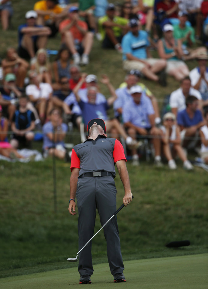 Photo - Rory McIlroy, of Northern Ireland, misses a birdie putt on the 18th hole during the first round of the PGA Championship golf tournament at Valhalla Golf Club on Thursday, Aug. 7, 2014, in Louisville, Ky. (AP Photo/Mike Groll)