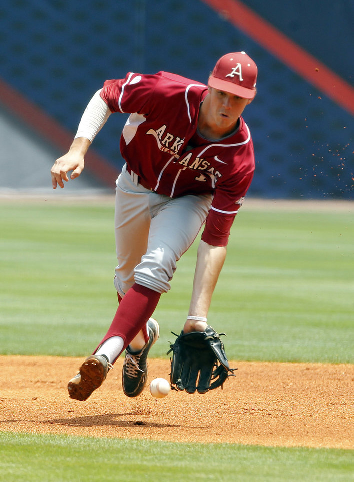Photo - Arkansas' Brian Anderson (1) fields a ground ball against LSU during the first inning at the Southeastern Conference NCAA college baseball tournament on Saturday, May 24, 2014, in Hoover, Ala. (AP Photo/Butch Dill)