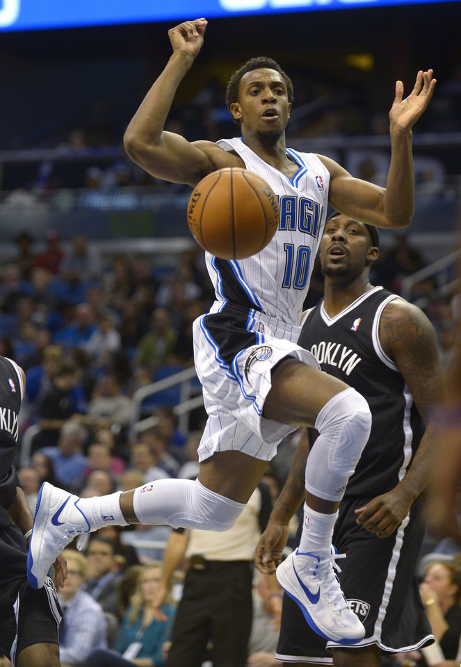 Orlando Magic guard Ish Smith (10) loses control of the ball while going up for a shot in front of Brooklyn Nets center Andray Blatche, right, during the first half of an NBA basketball game in Orlando, Fla., Friday, Nov. 9, 2012.(AP Photo/Phelan M. Ebenhack)