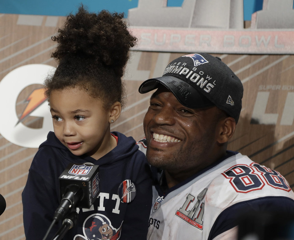Photo - ADDS NAMES OF SUBJECTS - New England Patriots' Martellus Bennett appears at a news conference with his daughter Austyn Jett Rose Bennett after the NFL Super Bowl 51 football game Sunday, Feb. 5, 2017, in Houston. The New England Patriots won 34-28 in overtime. (AP Photo/Chuck Burton)